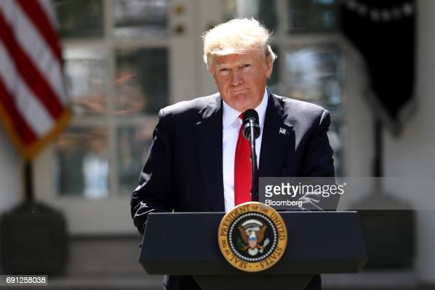 US President Donald Trump pauses while speaking during an announcement in the Rose Garden of the White House in Washington DC US on Thursday June 1...