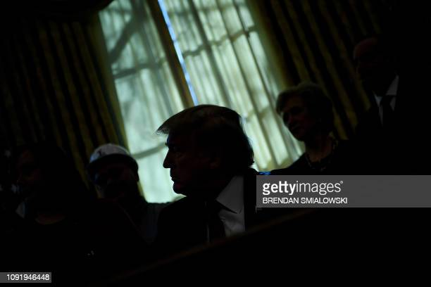President Donald Trump pauses while speaking during an executive order signing in the Oval Office of the White House January 31 2019 in Washington DC...