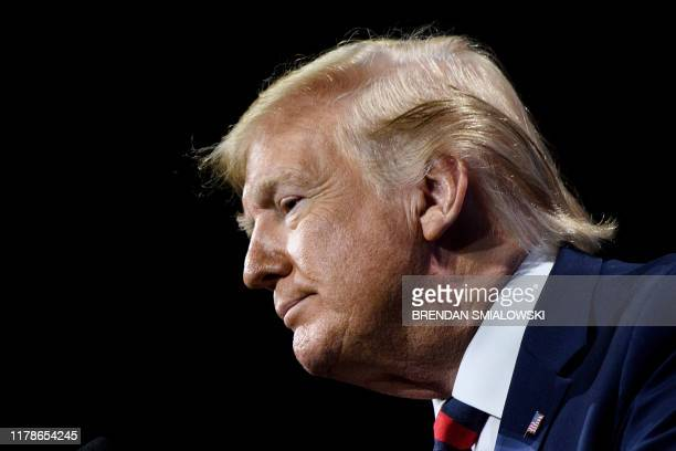 US President Donald Trump pauses while speaking during the International Association of Chiefs of Police Annual Conference and Exposition at the...