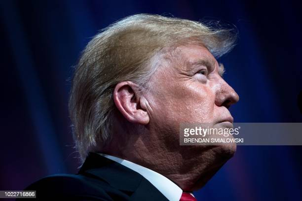 US President Donald Trump pauses while speaking during the Ohio Republican Party State Dinner at the Greater Columbus Convention Center August 24...