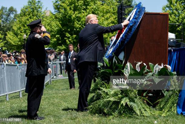 US President Donald Trump places a flower on a wreath during the 38th annual National Peace Officers Memorial Day service at the US Capitol in...