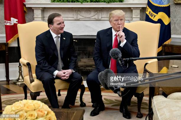 US President Donald Trump places his finger over his mouth before speaking during a meeting with Stefan Lofven Sweden's prime minister left in the...