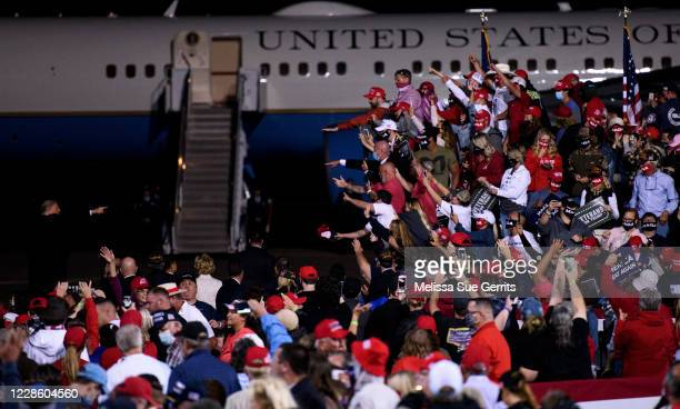President Donald Trump points to a crowd while walking back to Air Force One after a Make America Great Again campaign rally on September 19, 2020 in...