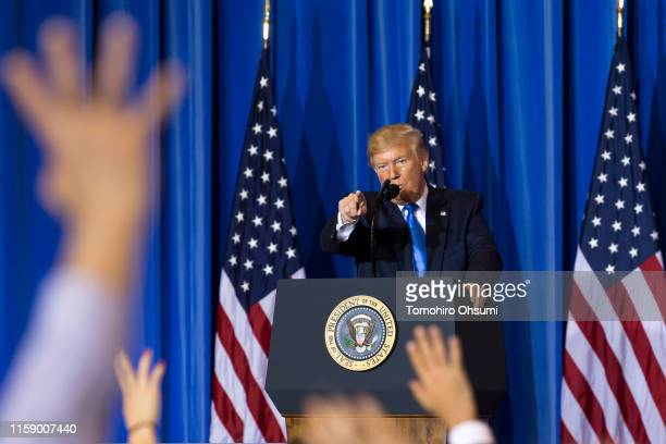 President Donald Trump points to a journalist as he takes questions during a press conference after the G-20 Summit on June 29, 2019 in Osaka, Japan....