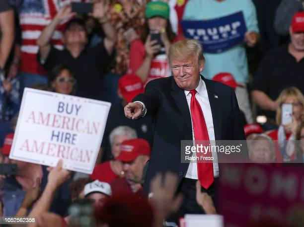 President Donald Trump points to a supporter during a rally at the International Air Response facility on October 19 2018 in Mesa Arizona President...