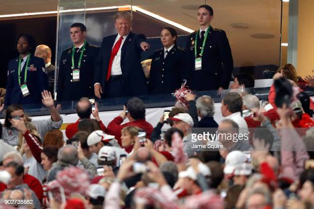 S President Donald Trump points to fans prior to the CFP National Championship presented by ATT between the Georgia Bulldogs and the Alabama Crimson...
