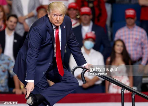 President Donald Trump points to his shoe as he speaks at a campaign rally at the BOK Center, June 20, 2020 in Tulsa, Oklahoma. Trump is holding his...