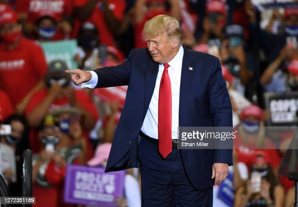 President Donald Trump points to the crowd after speaking at a campaign event at Xtreme Manufacturing on September 13, 2020 in Henderson, Nevada....