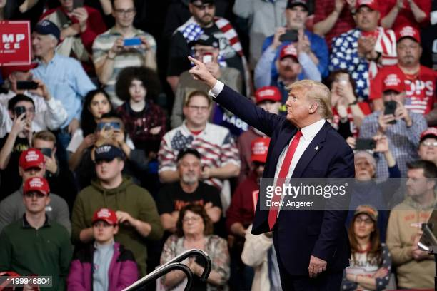 S President Donald Trump points to the crowd after speaking during a Keep America Great rally at Southern New Hampshire University Arena on February...