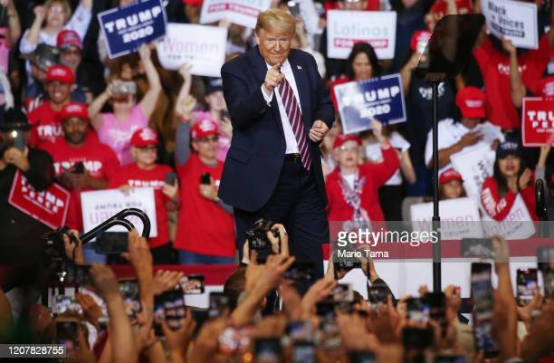 President Donald Trump points to the crowd at a campaign rally at Las Vegas Convention Center on February 21, 2020 in Las Vegas, Nevada. The upcoming...