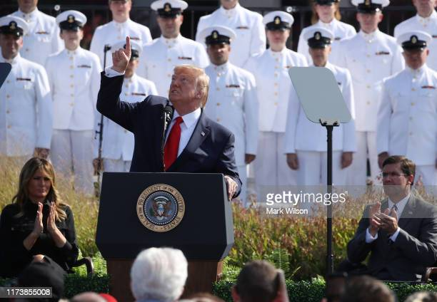 S President Donald Trump points to the sky during a 911 memorial ceremony at the Pentagon to commemorate the anniversary of the 9/11 terror attacks...