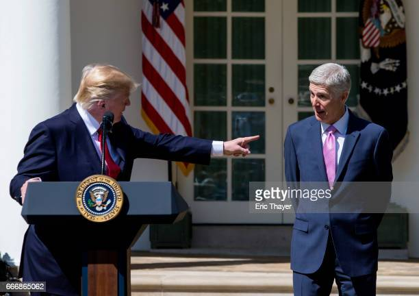 President Donald Trump points to US Supreme Court Associate Justice Neil Gorsuch during a ceremony in the Rose Garden at the White House April 10...