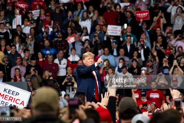 """President Donald Trump points toward the crowd at the conclusion of a """"Keep America Great"""" campaign rally at the Huntington Center on January 9, 2020..."""