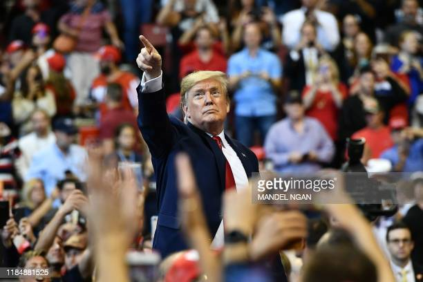 US President Donald Trump points with his finger to supporters during a Keep America Great campaign rally at the BBT Center in Sunrise Florida on...