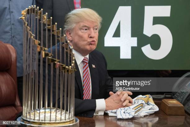 US President Donald Trump ponders a question from the press as he meets with members of the 2016 World Series Champions Chicago Cubs baseball team in...