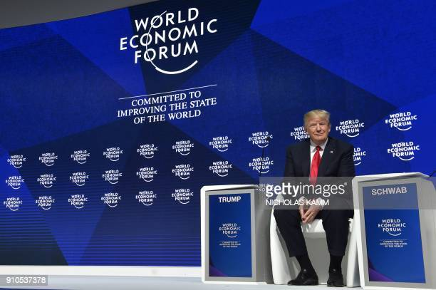 US President Donald Trump poses before delivering a speech during the World Economic Forum annual meeting on January 26 2018 in Davos eastern...
