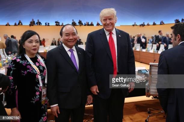 S President Donald Trump poses for a photo with Vietnamese Prime Minister Nguyen Xuan Phuc prior to the morning working session on the second day of...