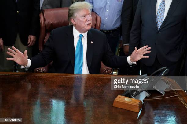 S President Donald Trump poses for photographs with farmers and ranchers from across the country in the Oval Office at the White House May 23 2019 in...