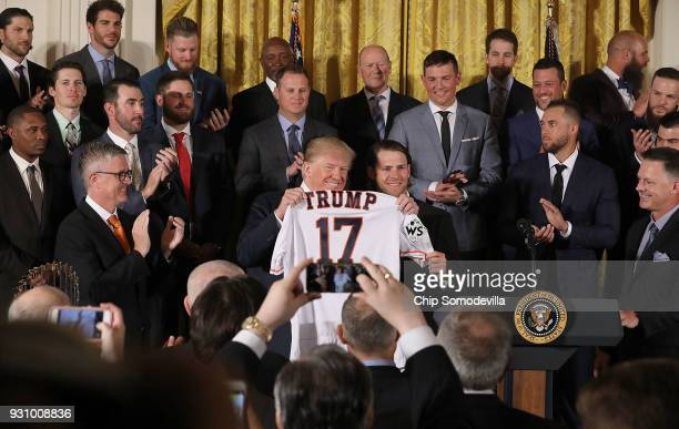S President Donald Trump poses for photographs with Houston Astros outfielder Josh Reddick while celebrating the team's World Series victory in the...