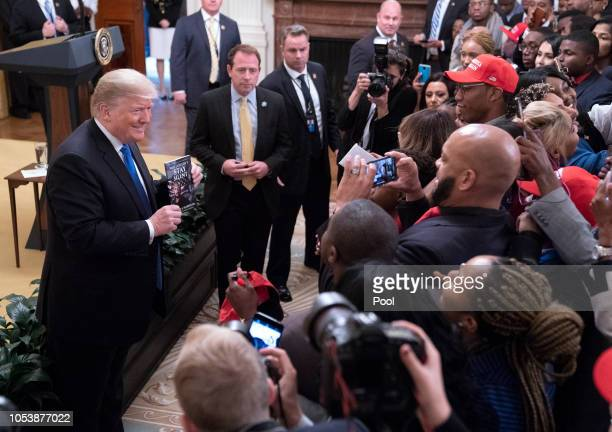 US President Donald Trump poses for photos after addressing young black conservative leaders from across the country as part of the 2018 Young Black...