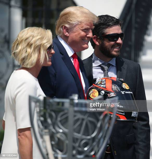 S President Donald Trump poses for pictures with 2017 Monster Energy NASCAR Cup Series champion Martin Truex Jr and his longtime girlfriend Sherry...