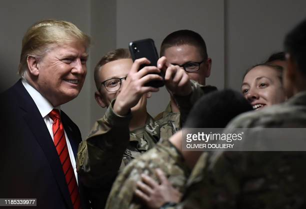 President Donald Trump poses for selfies during a Thanksgiving dinner with US troops at Bagram Air Field during a surprise visit on November 28 2019...
