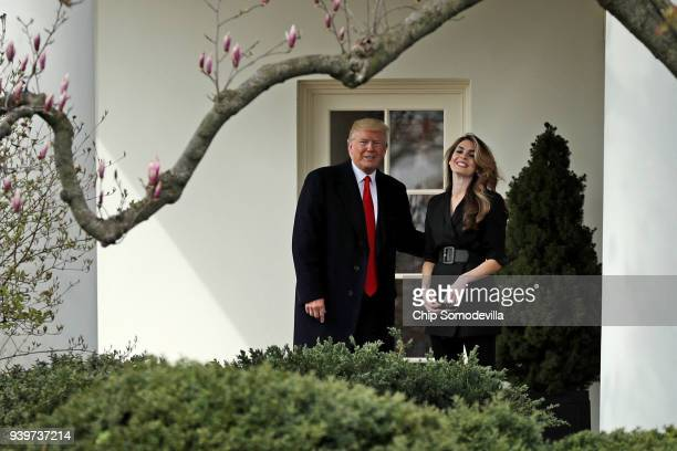 President Donald Trump poses for the news media with Communications Director Hope Hicks on her last day of work at the White House before he departs...