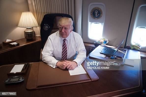 Us President Donald Trump Poses In His Office Aboard Air