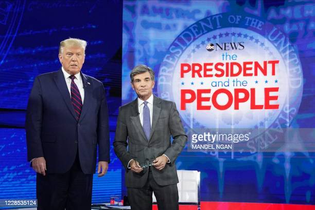 President Donald Trump poses with ABC New anchor George Stephanopoulos ahead of a town hall event at the National Constitution Center in...