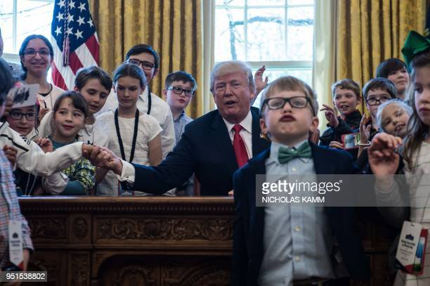 US President Donald Trump poses with children of press and staff during Take your Daughters and Sons to Work Day in the Oval Office at the White...