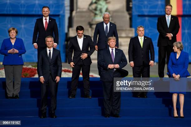 President Donald Trump poses with Germany's Chancellor Angela Merkel , NATO Secretary General Jens Stoltenberg , Britain's Prime Minister Theresa May...