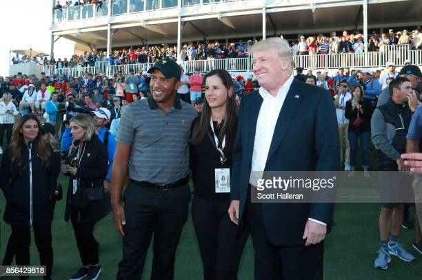 President Donald Trump poses with Jhonattan Vegas of Venezuela and the International Team and his wife wife Hildegard Vegas during the trophy...