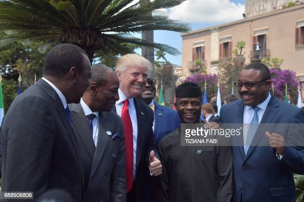 US President Donald Trump poses with Kenya's President Uhuru Kenyatta Guinea's President Alpha Conde Vice President of Nigeria Yemi Osinbajo and...