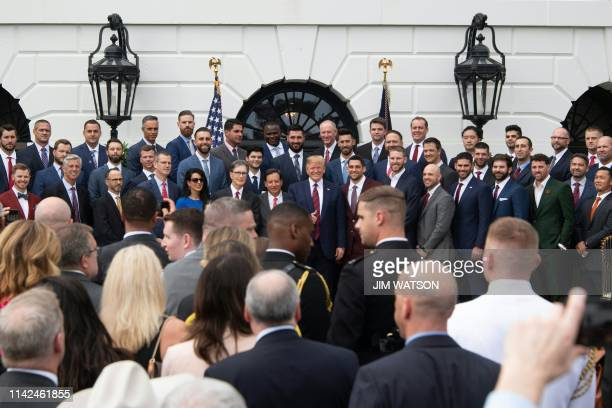 US President Donald Trump poses with the 2018 World Series Champions Boston Red Sox at the White House in Washington DC on May 9 2019
