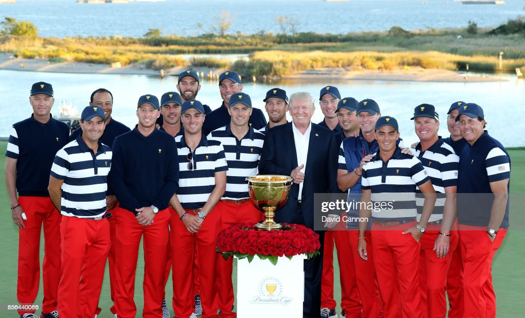US President Donald Trump poses with the victorious United States team led by Steve Stricker after their 19-11 win during the final day singles matches matches in the 2017 Presidents Cup at the Liberty National Golf Club on October 1, 2017 in Jersey City, New Jersey.