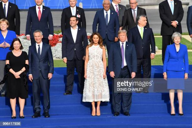 US President Donald Trump poses with US First Lady Melania Trump NATO Secretary General's wife Ingrid Schulerud NATO Secretary General Jens...