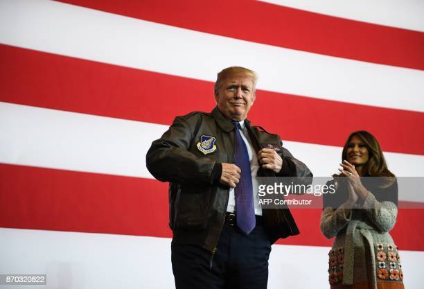 US President Donald Trump prepares to addresse US soldiers as his wife Melania looks on upon arriving at US Yokota Air Base in Tokyo on November 5...