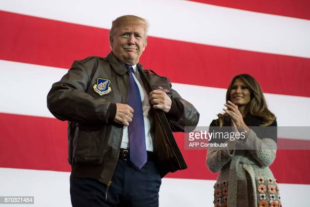 President Donald Trump prepares to addresse US soldiers as his wife Melania looks on upon arriving at US Yokota Air Base in Tokyo on November 5 2017...