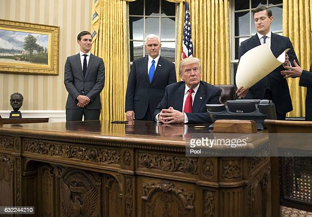 President Donald Trump prepares to sign a confirmation for Defense Secretary James Mattis in the Oval Office at the White House in Washington DC on...