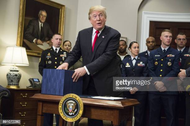 US President Donald Trump prepares to sign the National Defense Authorization Act for fiscal year 2018 in the Roosevelt Room of the White House in...