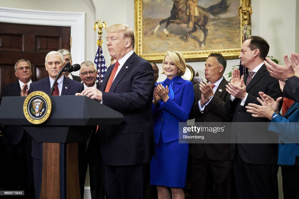 U.S. President Donald Trump prepares to speak before signing an executive order on health care in the Roosevelt Room of the White House in Washington, D.C., U.S., on Thursday, Oct. 12, 2017. Trumpsigned an executive order Thursday designed to expand health insurance options for some Americans, in a move that may also undermine coverage for those who remain in Obamacare. Photographer: T.J. Kirkpatrick/Bloomberg via Getty Images