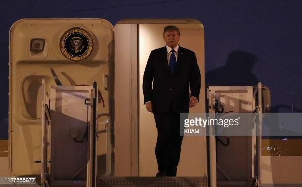 US President Donald Trump prepares to walk down Air Force One after arriving at Noi Bai airport in Hanoi on February 26 ahead of the second USNorth...