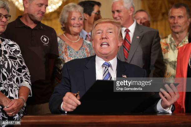 S President Donald Trump prepres to sign a proclaimation for Made in America Day and Made In America Week during a product showcase in the East Room...
