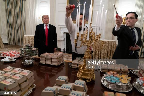 S President Donald Trump presents fast food to be served to the Clemson Tigers in celebration of their national championship at the White House on...