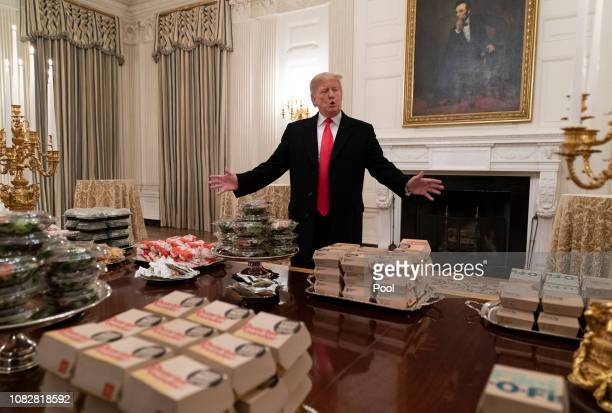 US President Donald Trump presents fast food to be served to the Clemson Tigers football team to celebrate their Championship at the White House on...