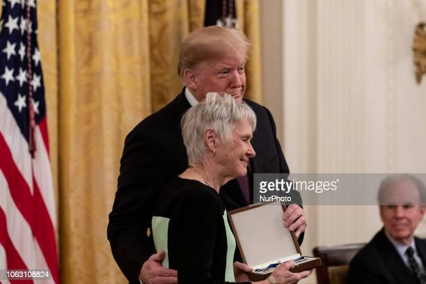 US President Donald Trump presents Maureen McCarthy Scalia wife of former US Supreme Court Justice Antonin Scalia with the Presidential Medal of...