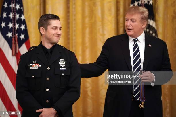 S President Donald Trump presents Ohio State University Law Enforcement Officer Alan Horujko with the Public Safety Officer Medal of Valor during a...
