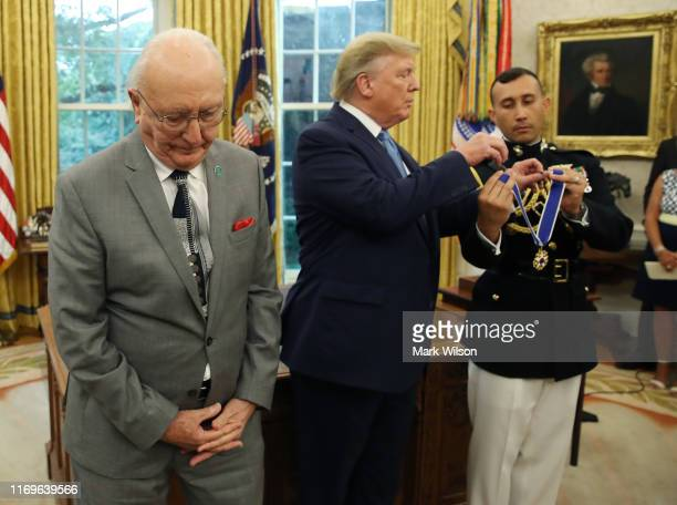 S President Donald Trump presents the Medal of Freedom to retired Boston Celtic Bob Cousy in the Oval Office at the White House on August 22 2019 in...