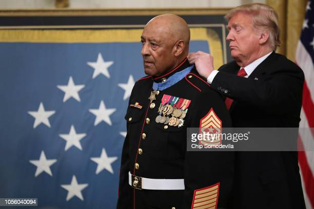 S President Donald Trump presents the Medal of Honor to retired Marine Sgt Major John L Canley during a ceremony in the East Room of the White House...