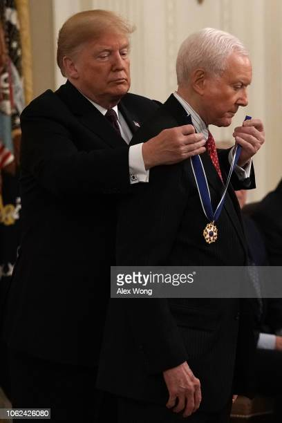 S President Donald Trump presents the Presidential Medal of Freedom to Sen Orrin Hatch during an East Room ceremony November 16 2018 in Washington DC...